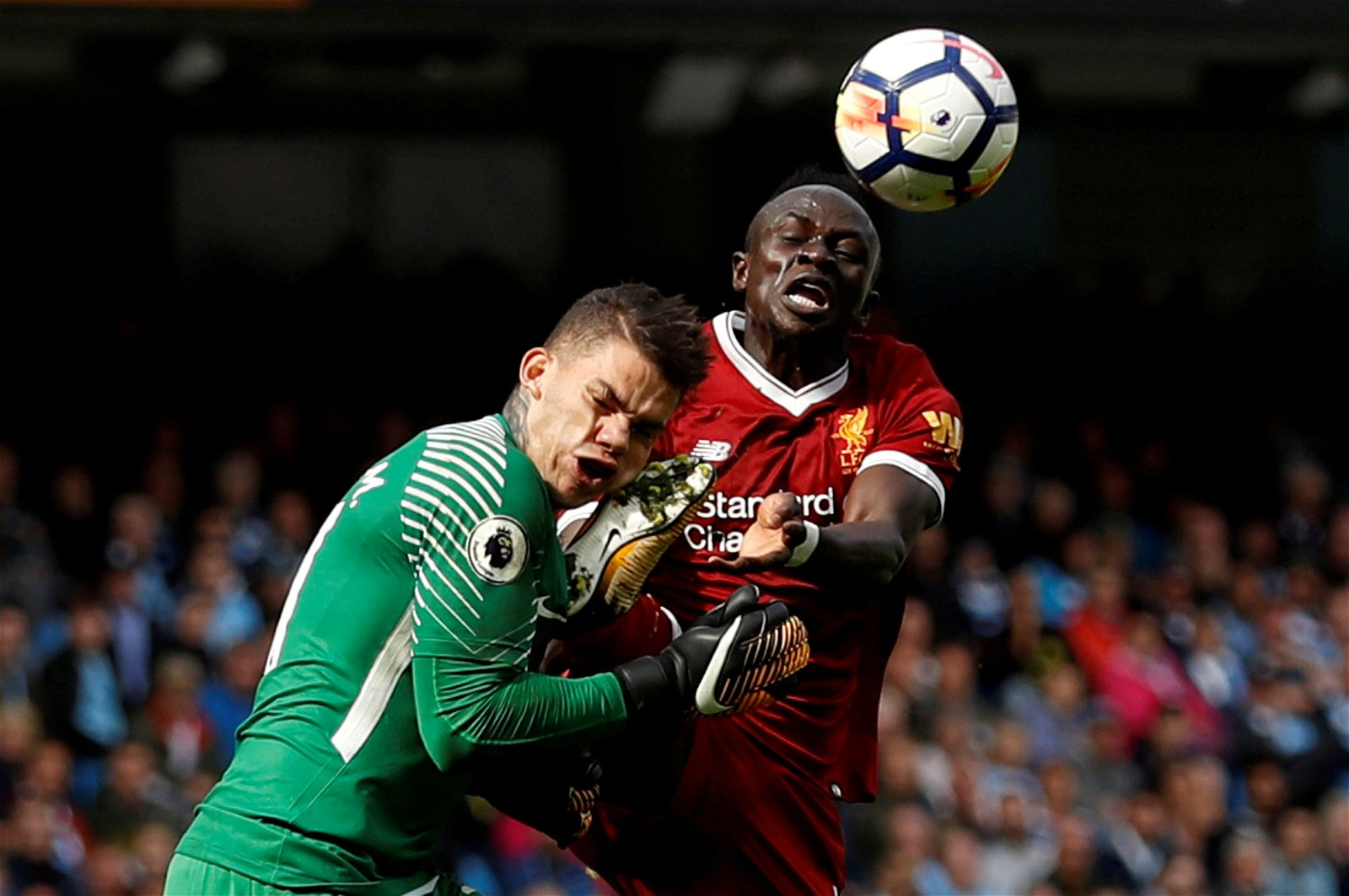 Liverpool's Sadio Mane clashes with Man City's Ederson