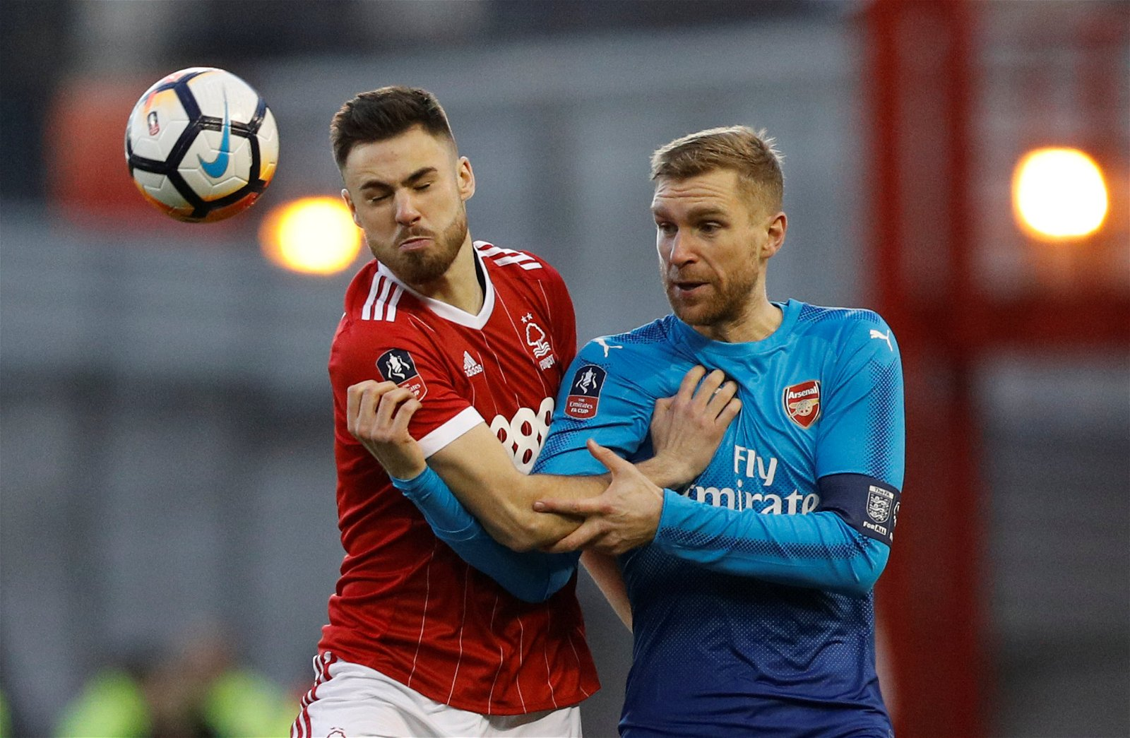 Per Mertesacker battles Ben Brereton for the ball
