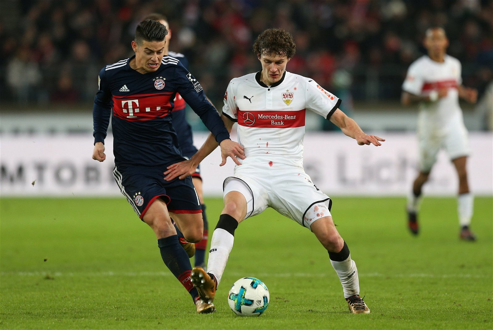 Benjamin Pavard in action with Bayern Munich's James Rodriguez