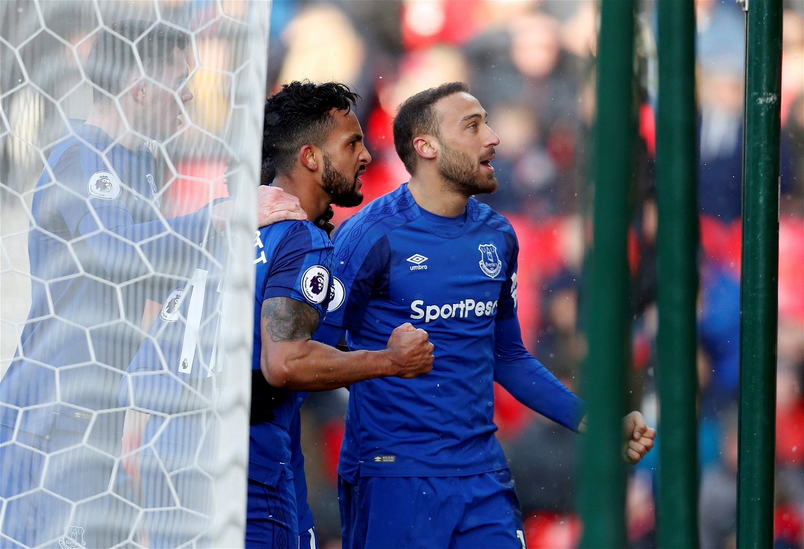 Cenk Tosun and Theo Walcott celebrate