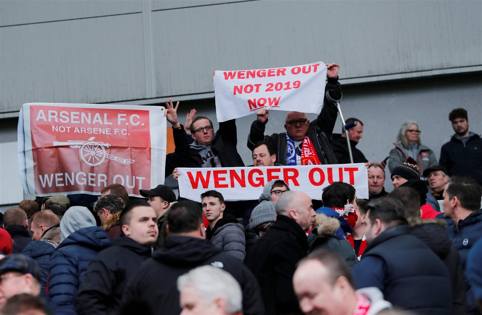 Arsenal fans holding Wenger Out signs during a 2-1defeat to Brighton