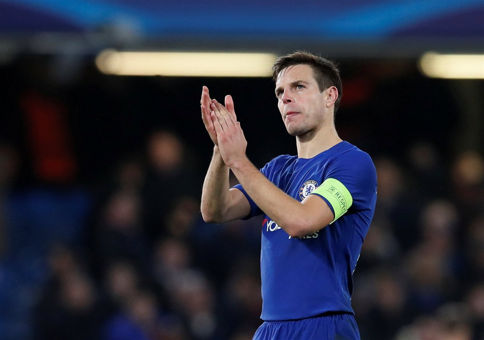 Cesar Azpilicueta applauds the Chelsea fans