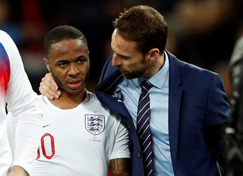 Gareth Southgate discusses with Raheem Sterling