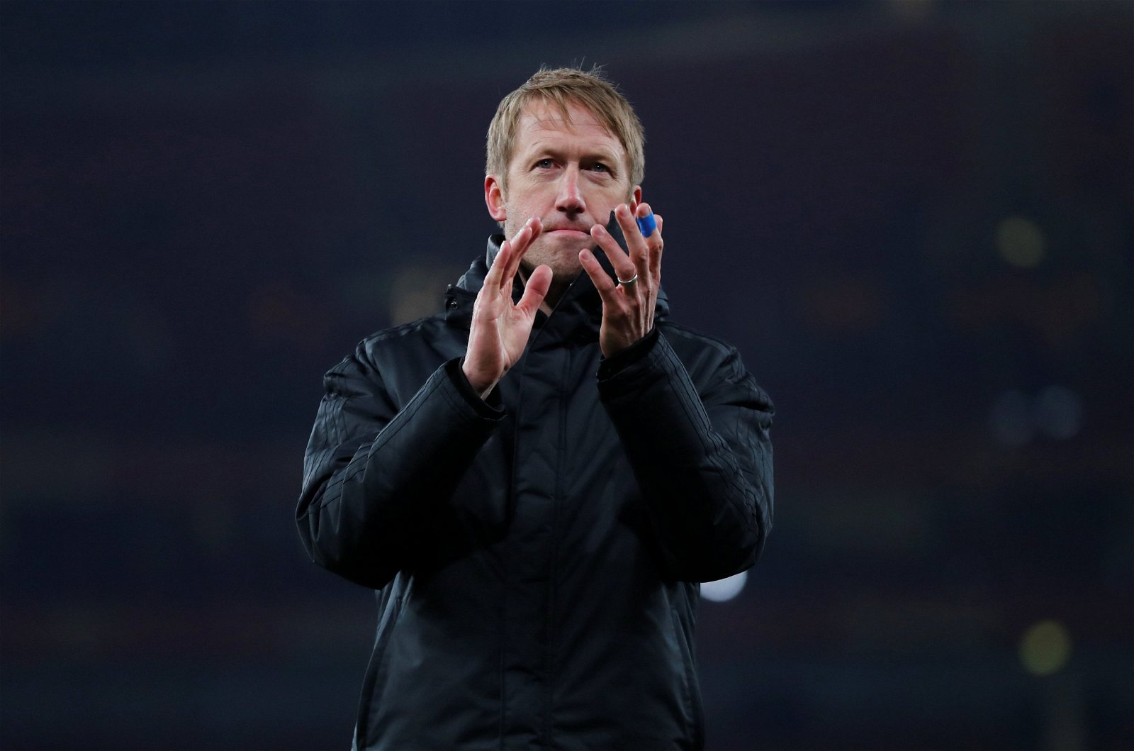 Graham Potter applauds the fans at the Emirates Stadium