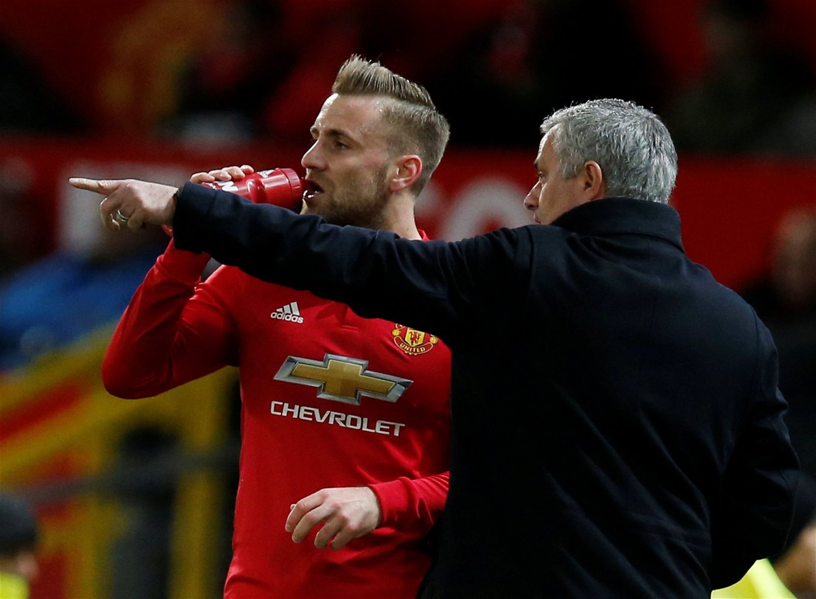 Jose Mourinho gives instructions to Luke Shaw