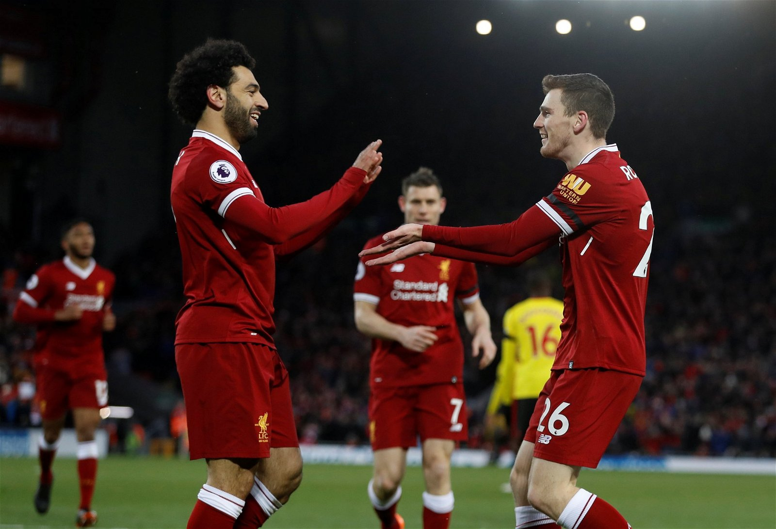 Liverpool's Andy Robertson celebrates after assisting a Mohamed Salah goal