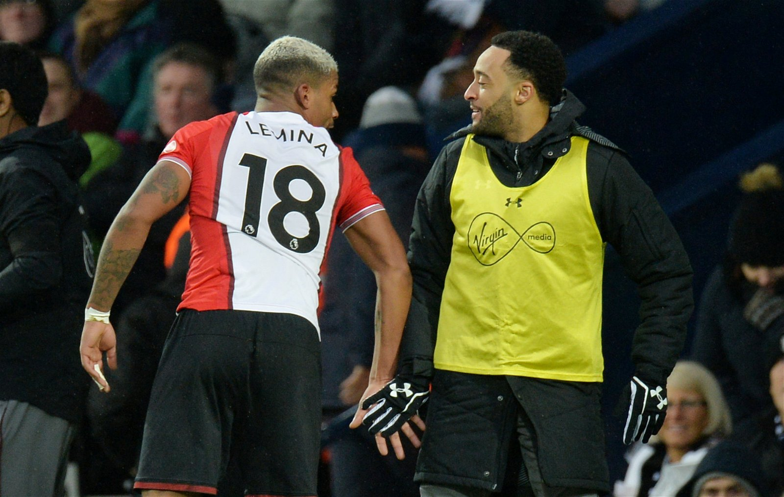 Mario Lemina talks to substitute Nathan Redmond
