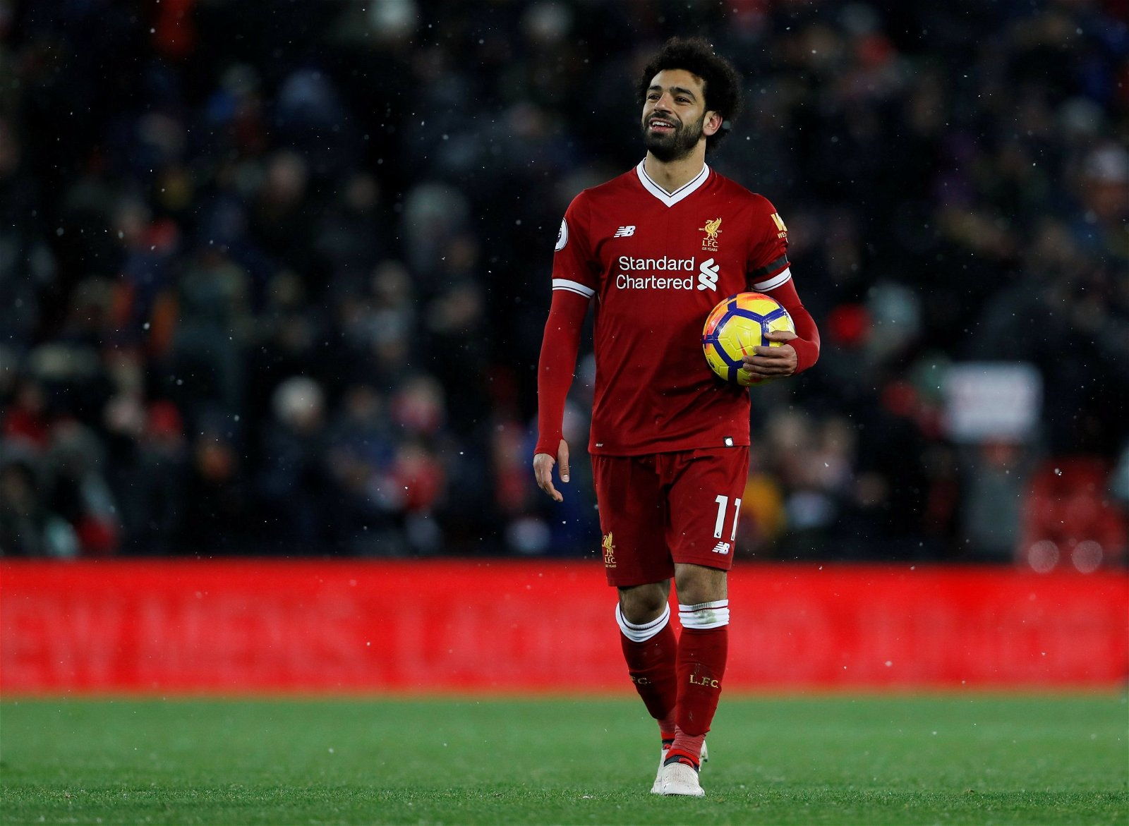 Mohamed Salah proudly holds the match ball after scoring four goals against Watford