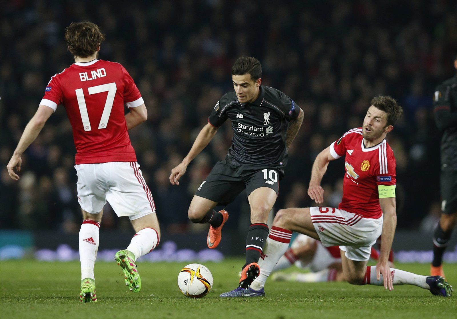 Philippe Coutinho tries to dribble past Daley Blind and Michael Carrick