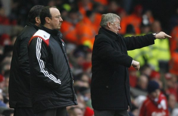 Manchester United's manager Ferguson gestures as Liverpool manager Benitez looks on during their English Premier League soccer match in Liverpool