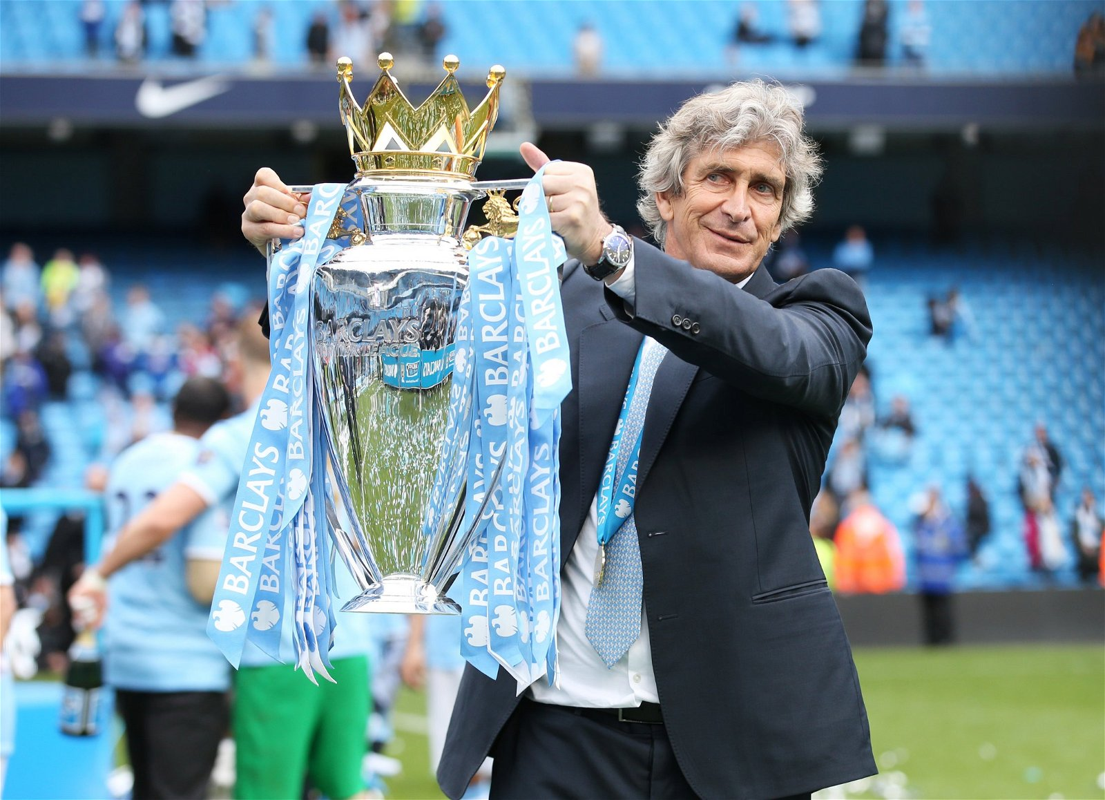 Manuel Pellegrini lifts the Premier League trophy at Manchester City
