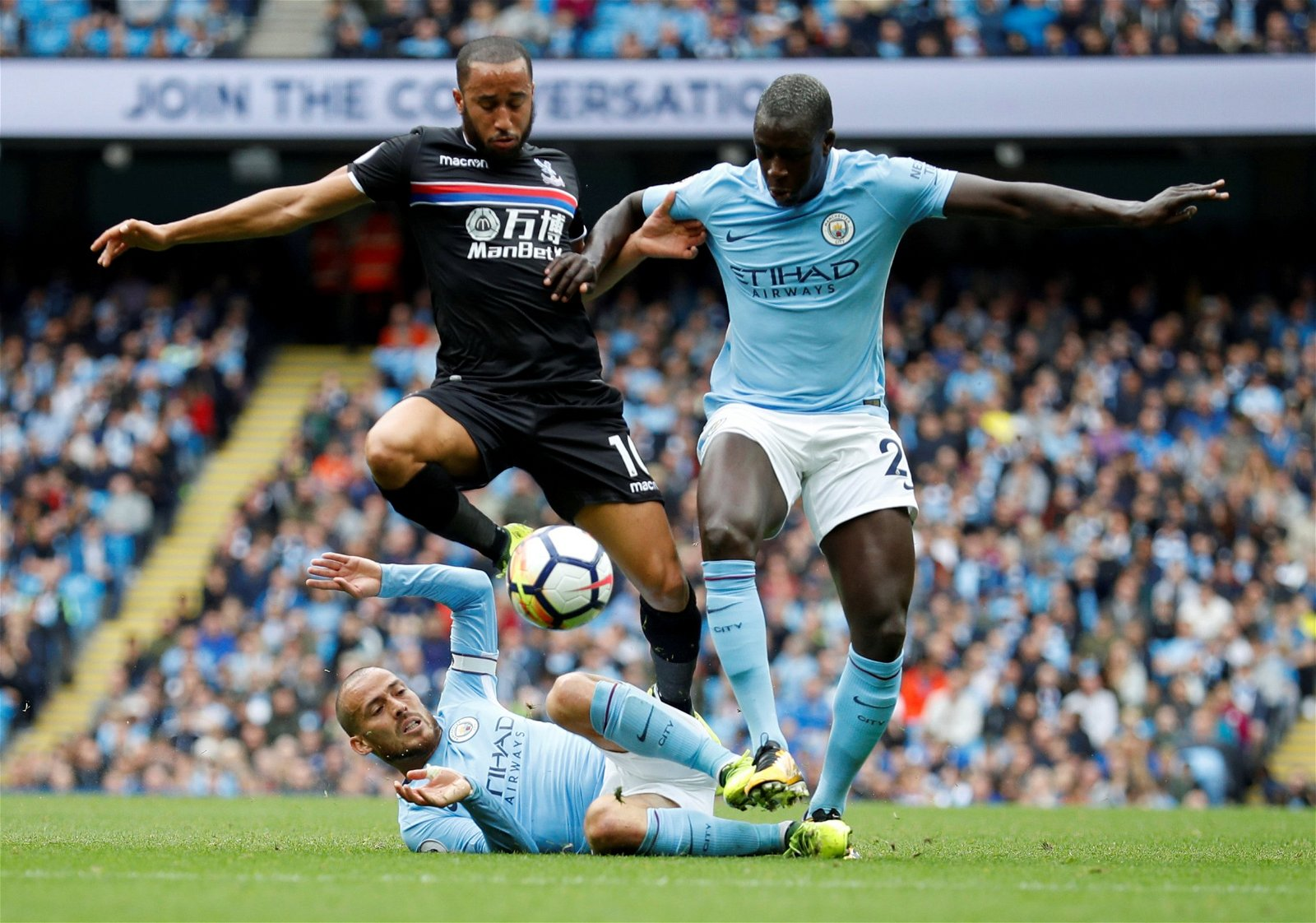 Man City's Benjamin Mendy and Andros Townsend of Crystal Palce
