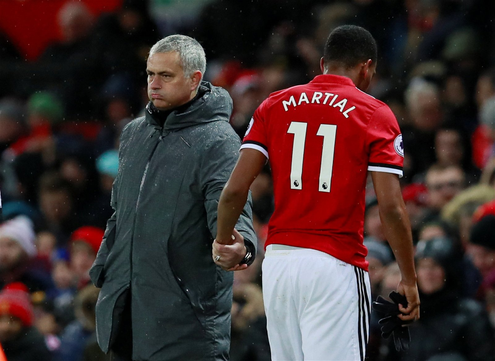 Manchester United manager Jose Mourinho shakes hands with Anthony Martial after he's substituted against Brighton