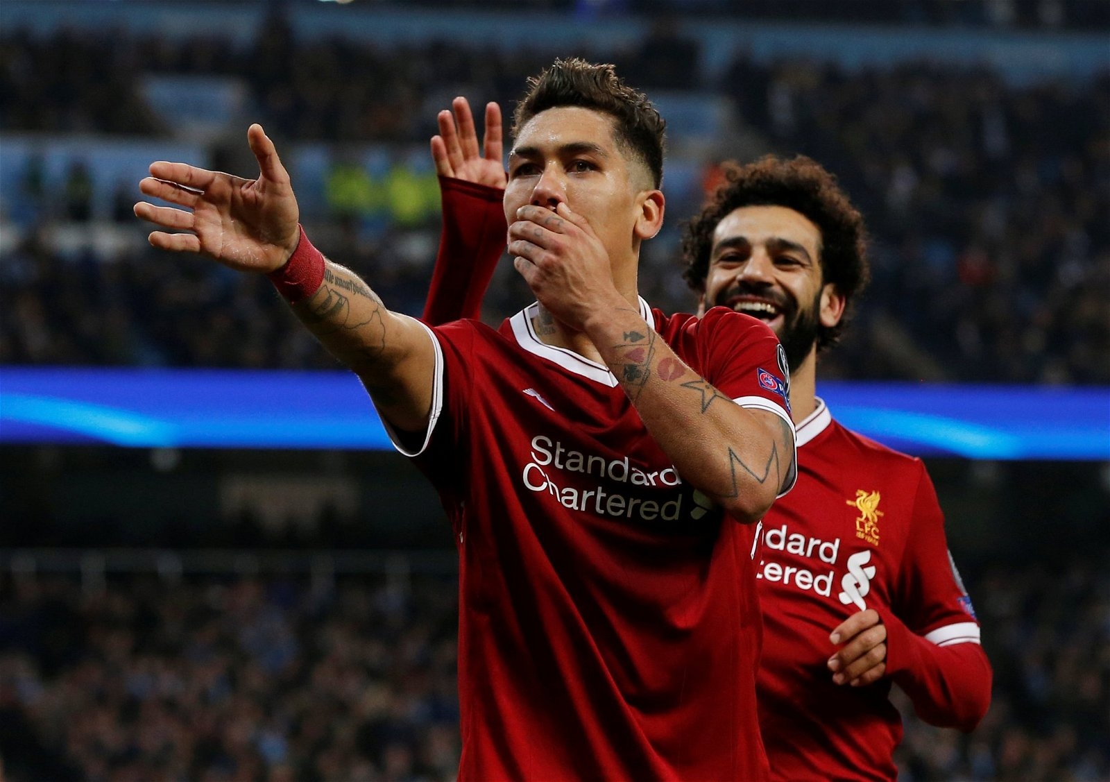 Liverpool's Roberto Firmino celebrates with Mohamed Salah after scoring against Manchester City