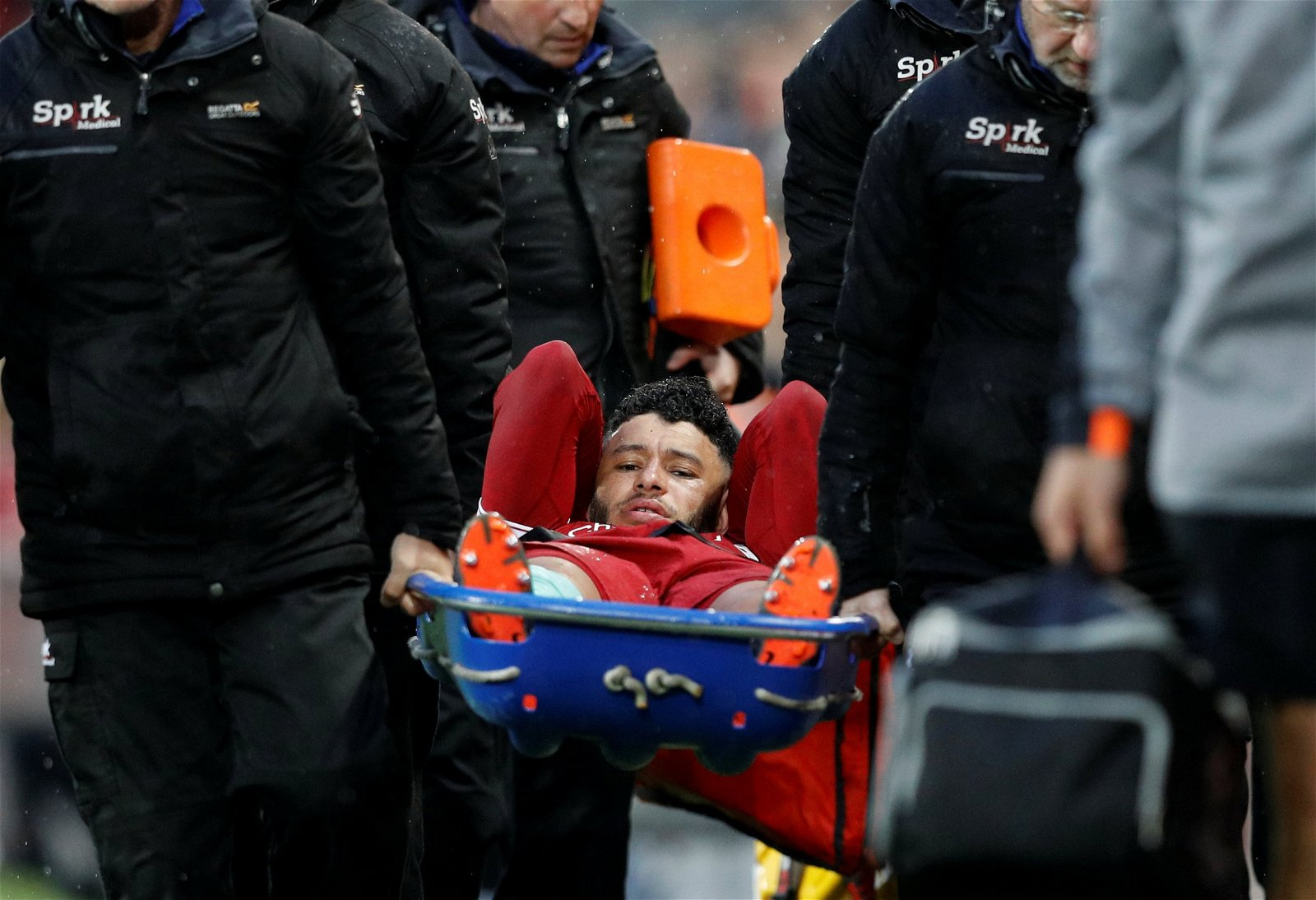 Liverpool's Alex Oxlade-Chamberlain is carried off on a stretcher against Roma