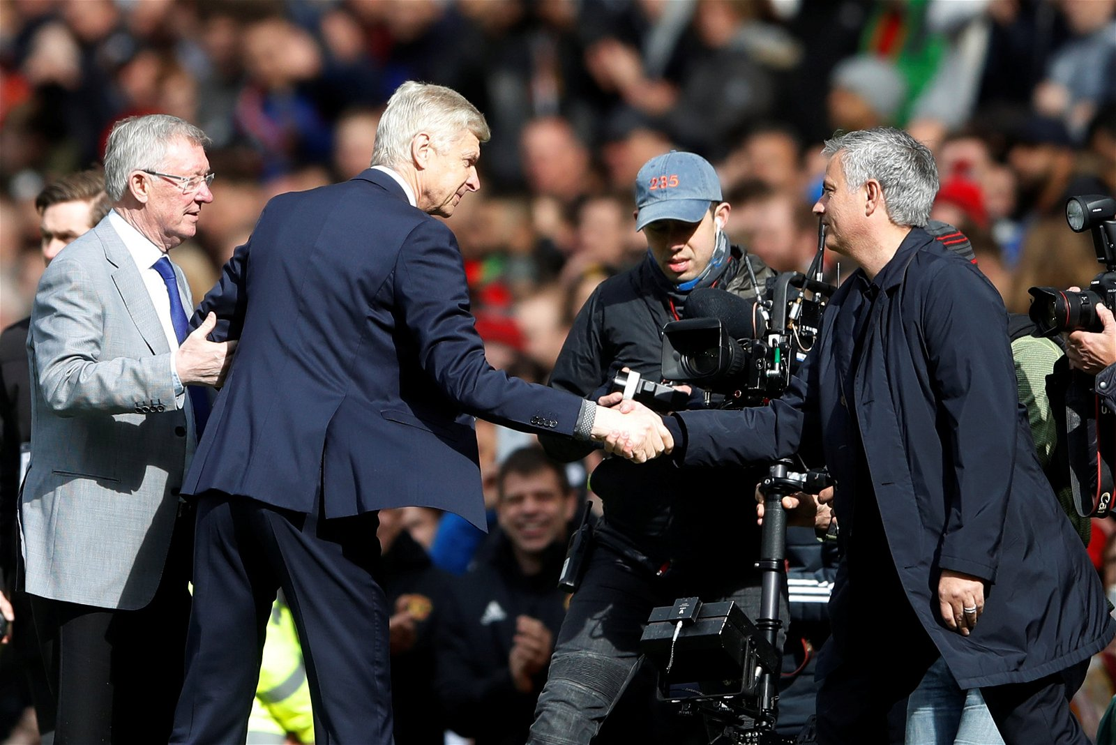 Sir Alex Ferguson presents Arsene Wenger with a gift at Old Trafford