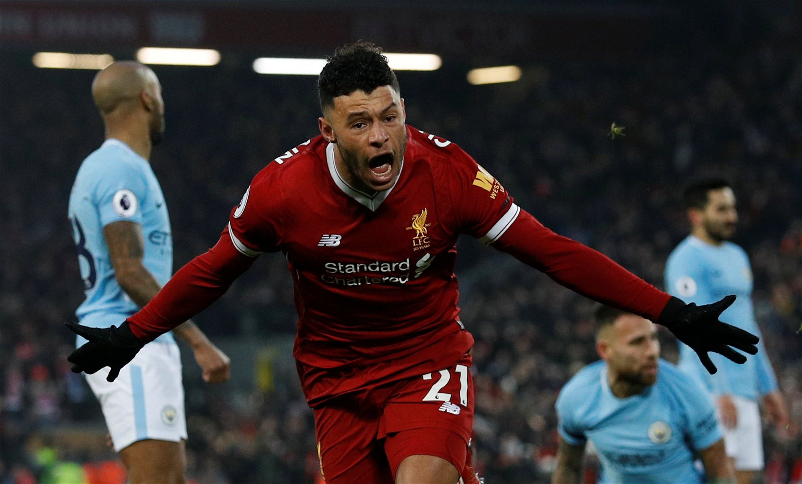 Alex Oxlade-Chamberlain celebrates scoring against Manchester City