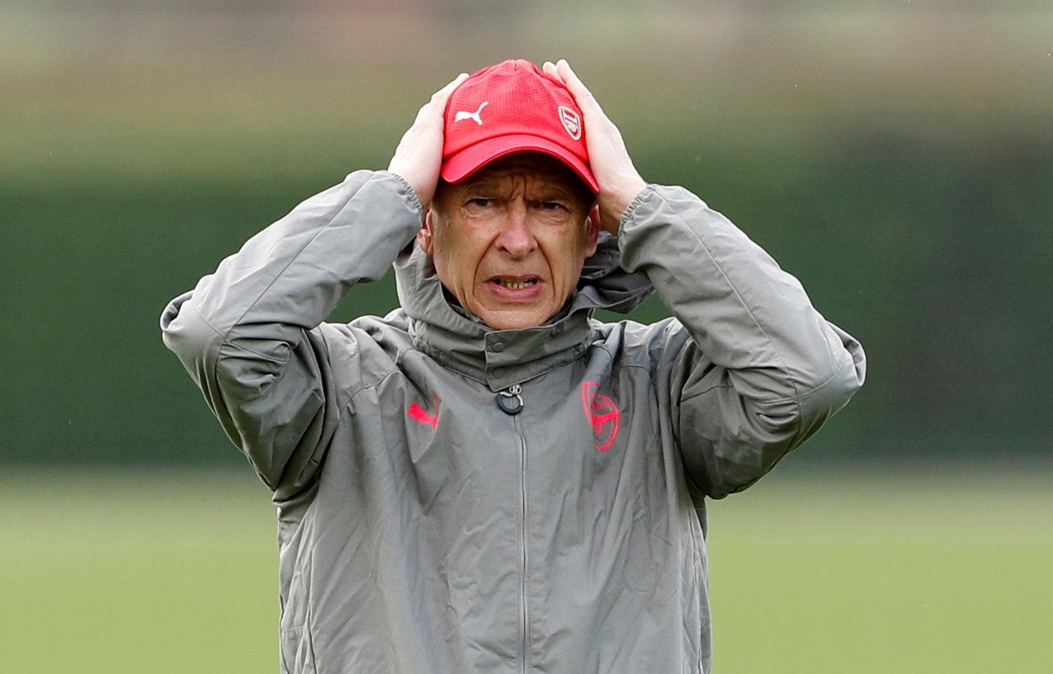Arsene Wenger holds his head in training