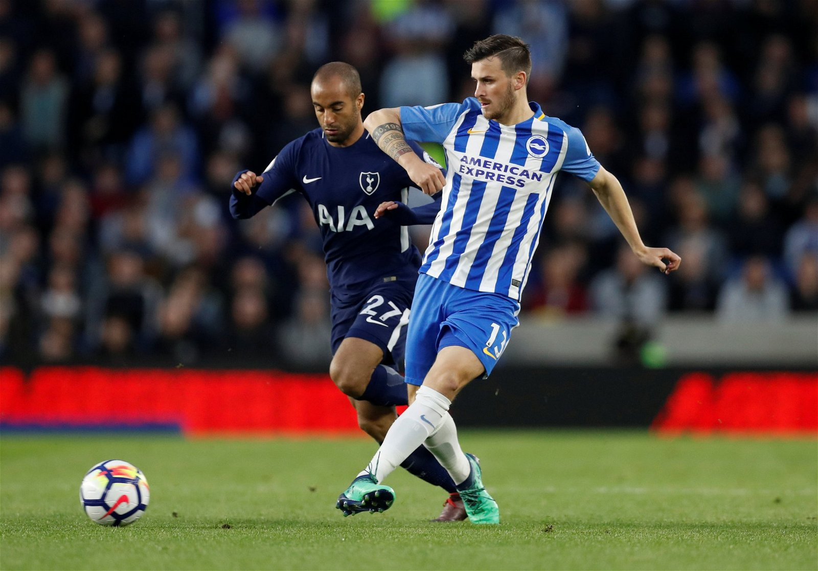 Brighton star Pascal Gross in action with Lucas Moura