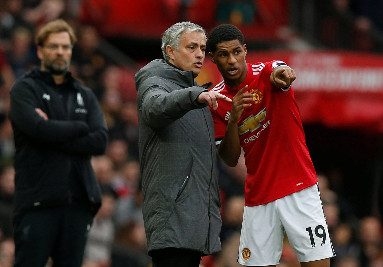 Jose Mourinho and Marcus Rashford in discussion