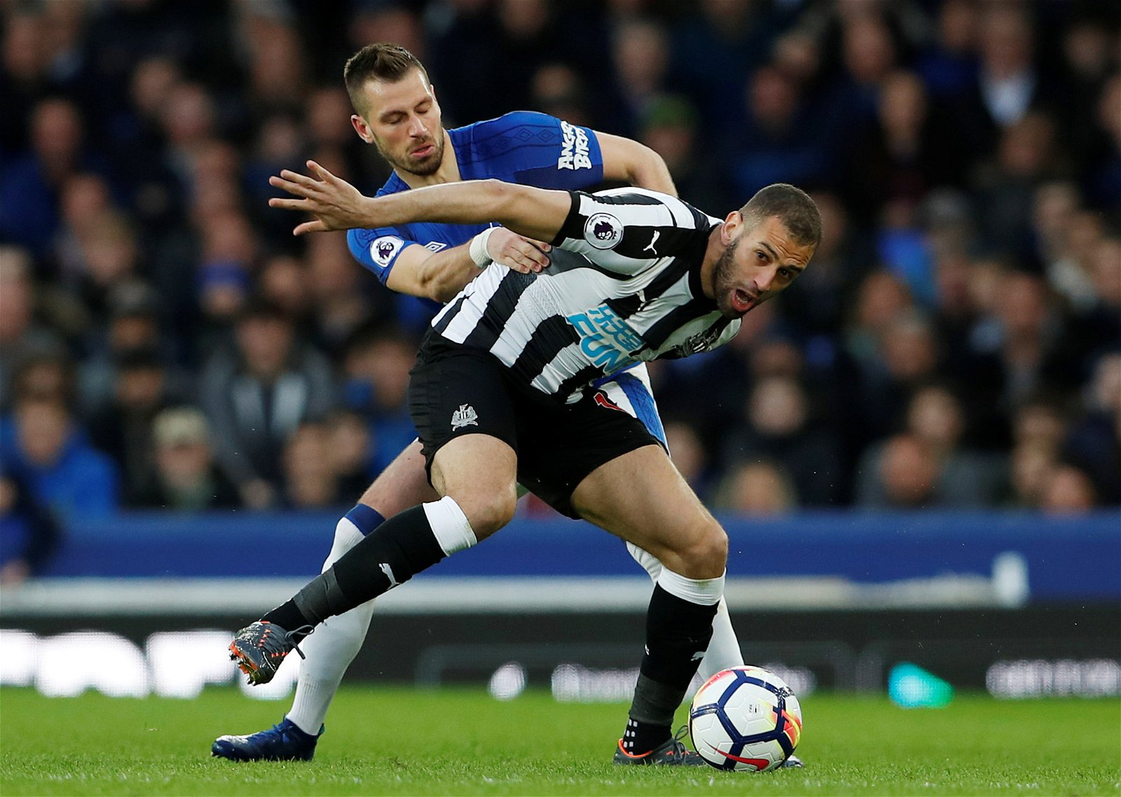 Morgan Schneiderlin tussles with Islam Slimani