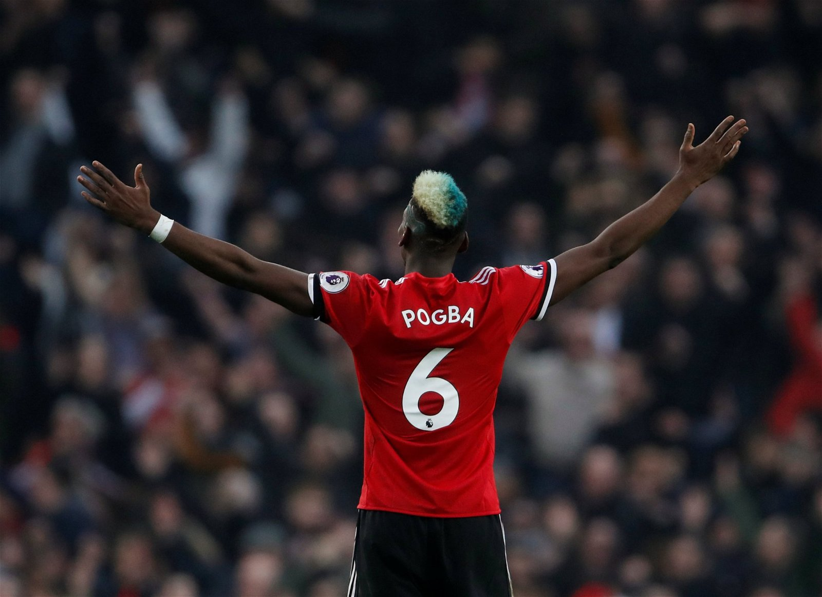 Paul Pogba celebrates winning against Manchester City