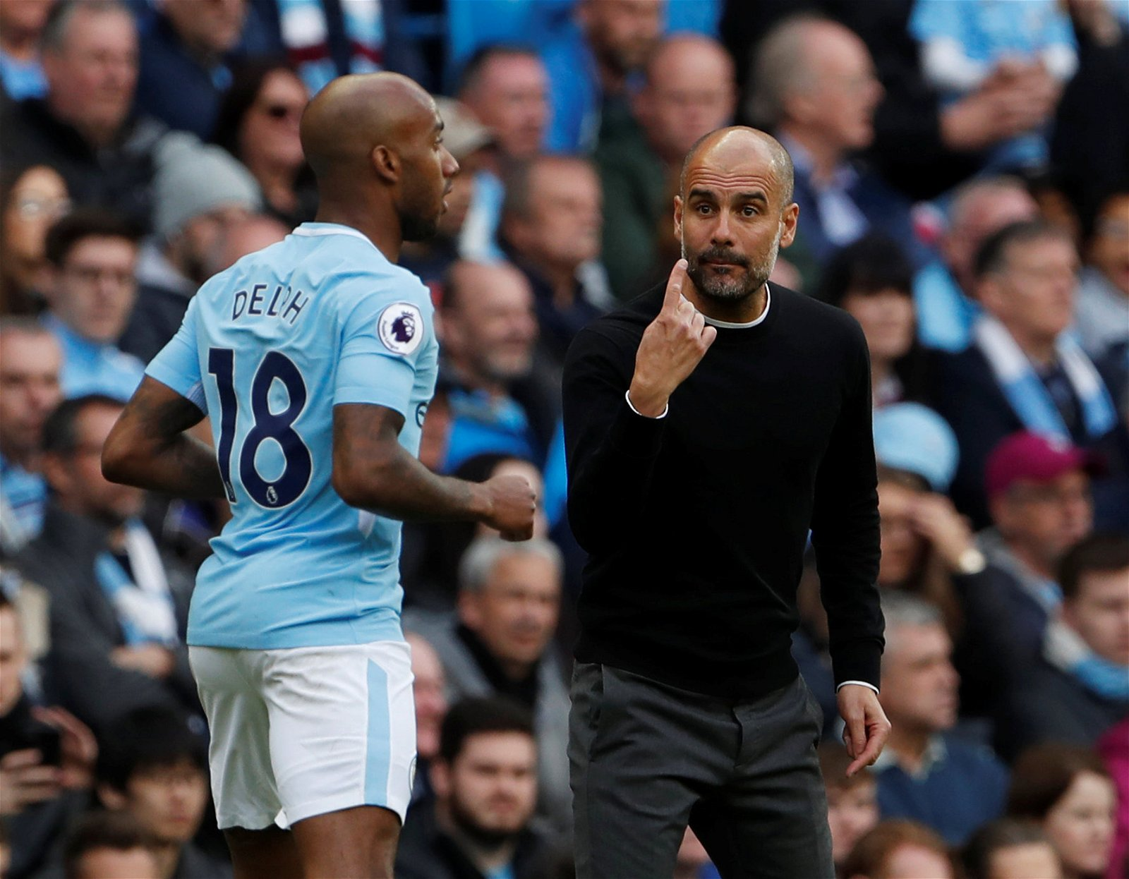 Pep Guardiola gives orders to Fabian Delph