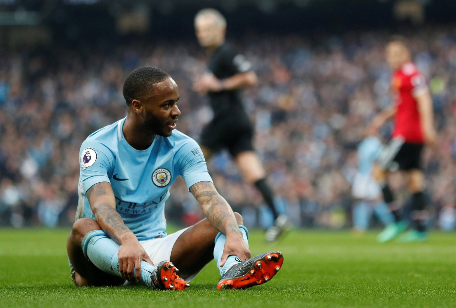 Raheem Sterling sits on the floor exhausted