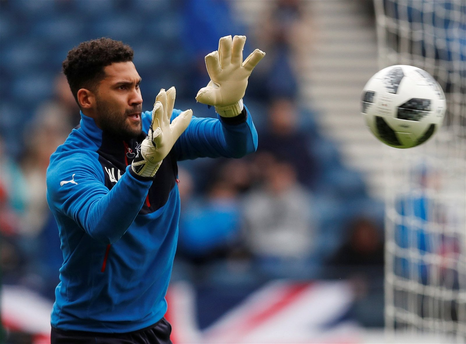 Wes Foderingham warms up ahead of a Rangers match