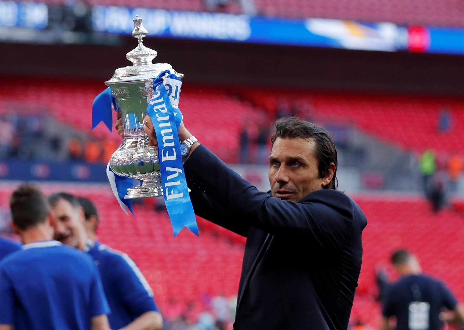 Chelsea manager Antonio Conte lifts the FA Cup trophy at Wembley