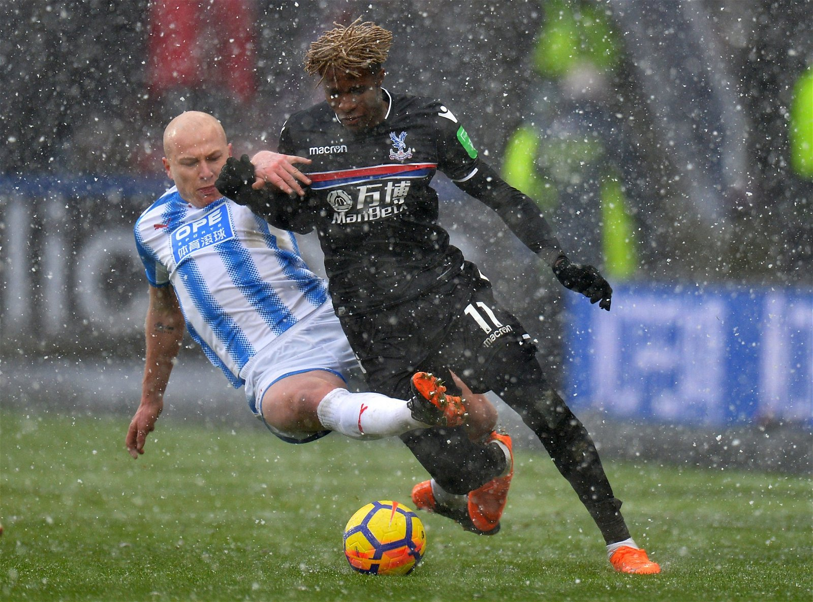 Aaron Mooy in action with Wilfried Zaha