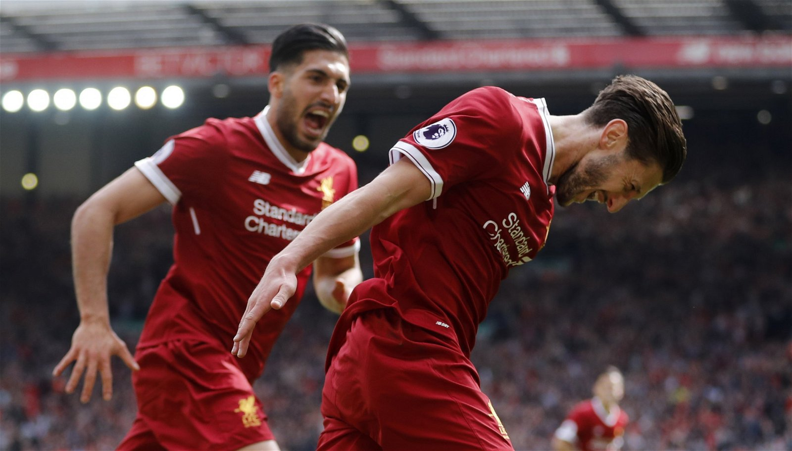 Adam Lallana celebrates with Emre Can