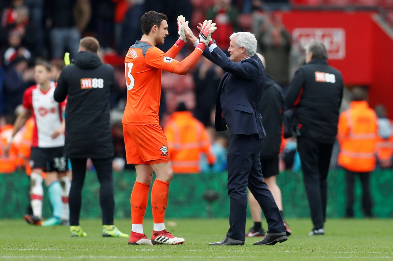 Alex McCarthy celebrates with Mark Hughes