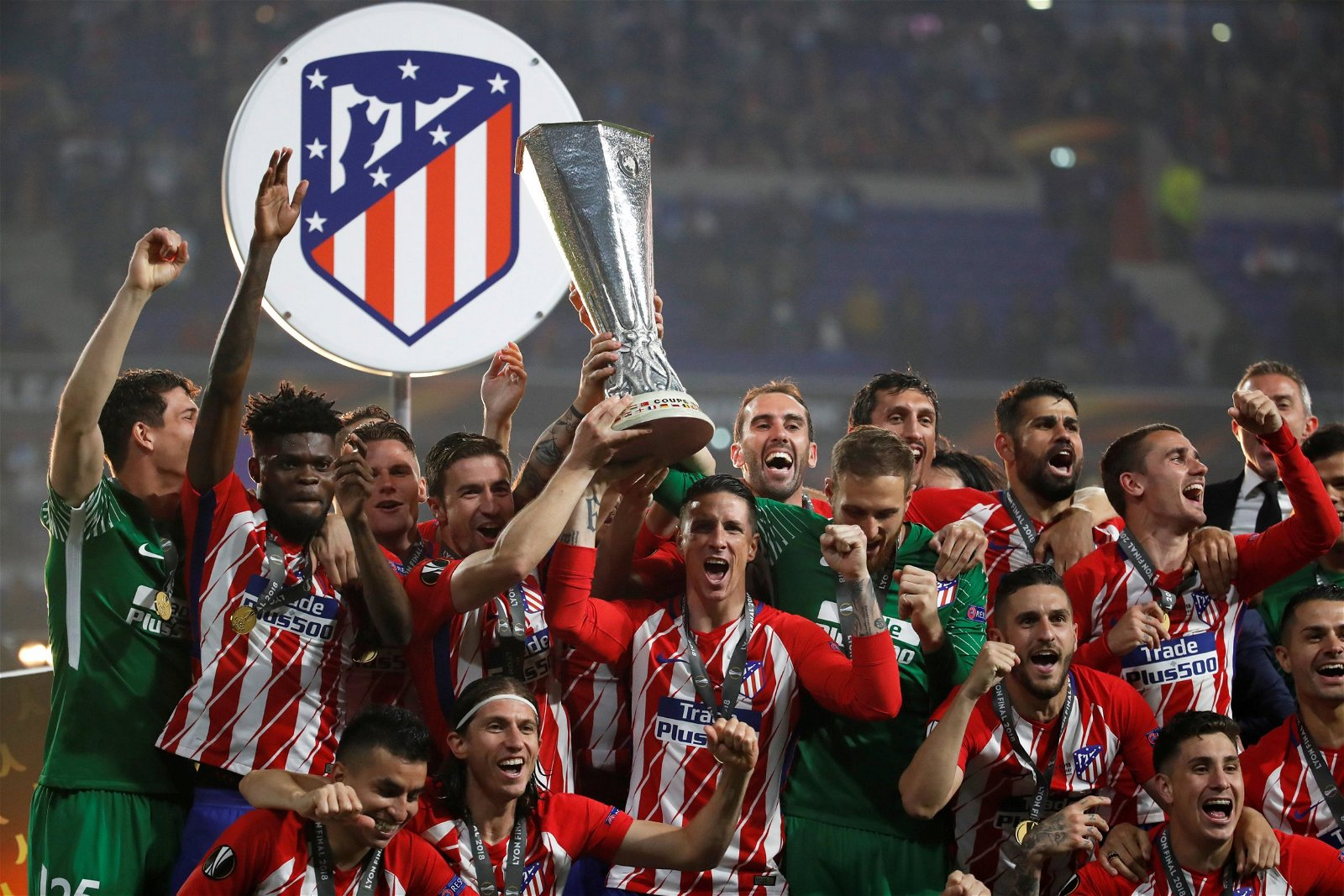 Atletico Madrid's players lift the Europa League trophy
