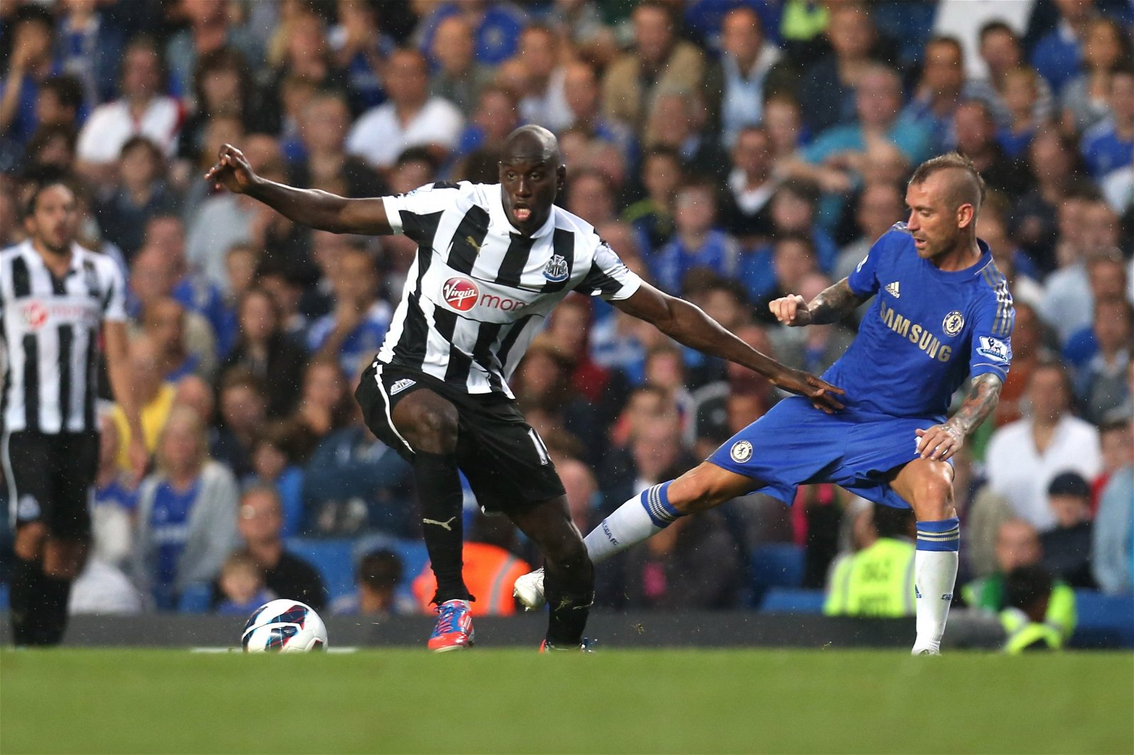Demba Ba takes on Raul Meireles