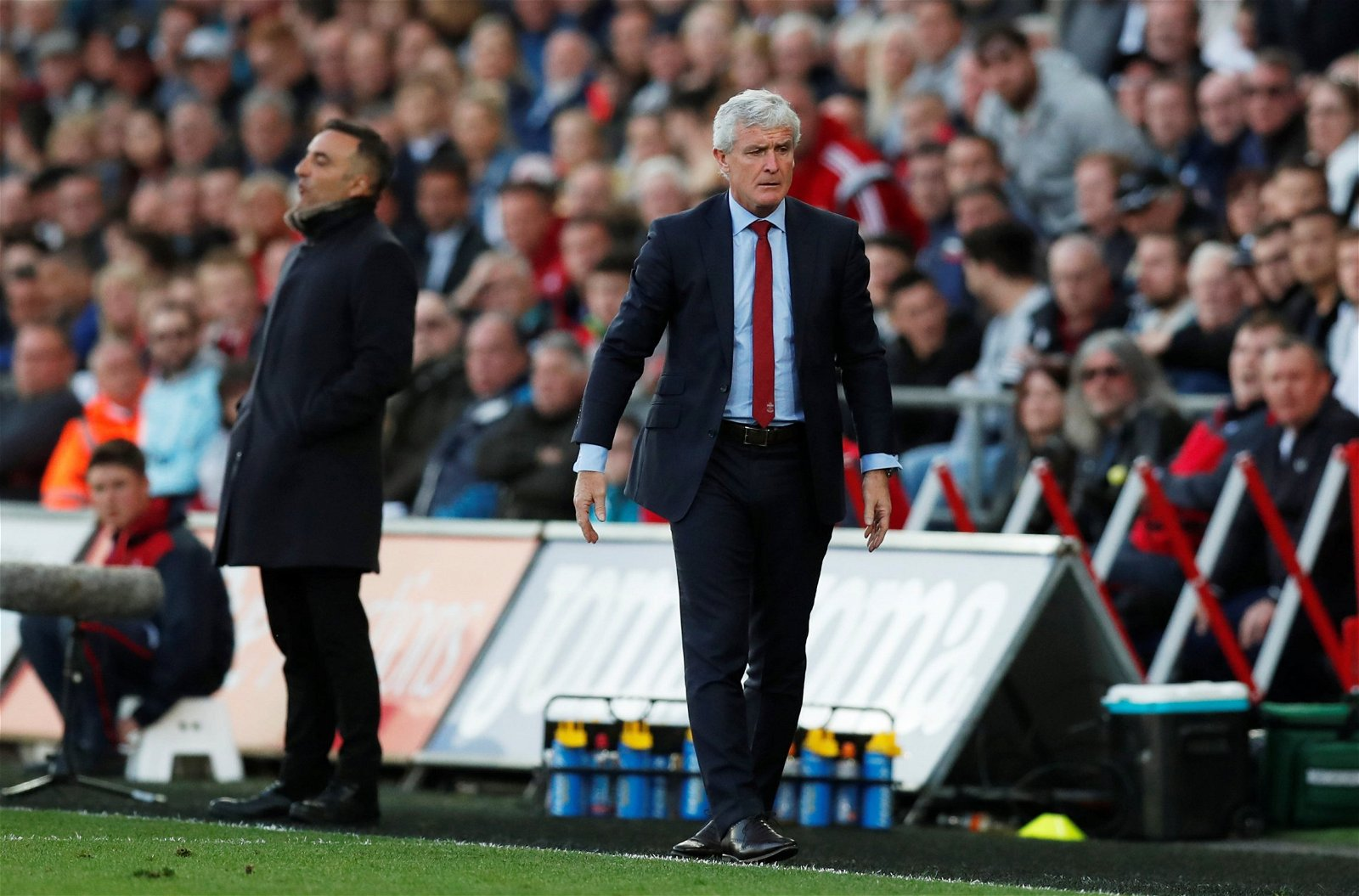 Mark Hughes and Carlos Carvalhal on the touchline