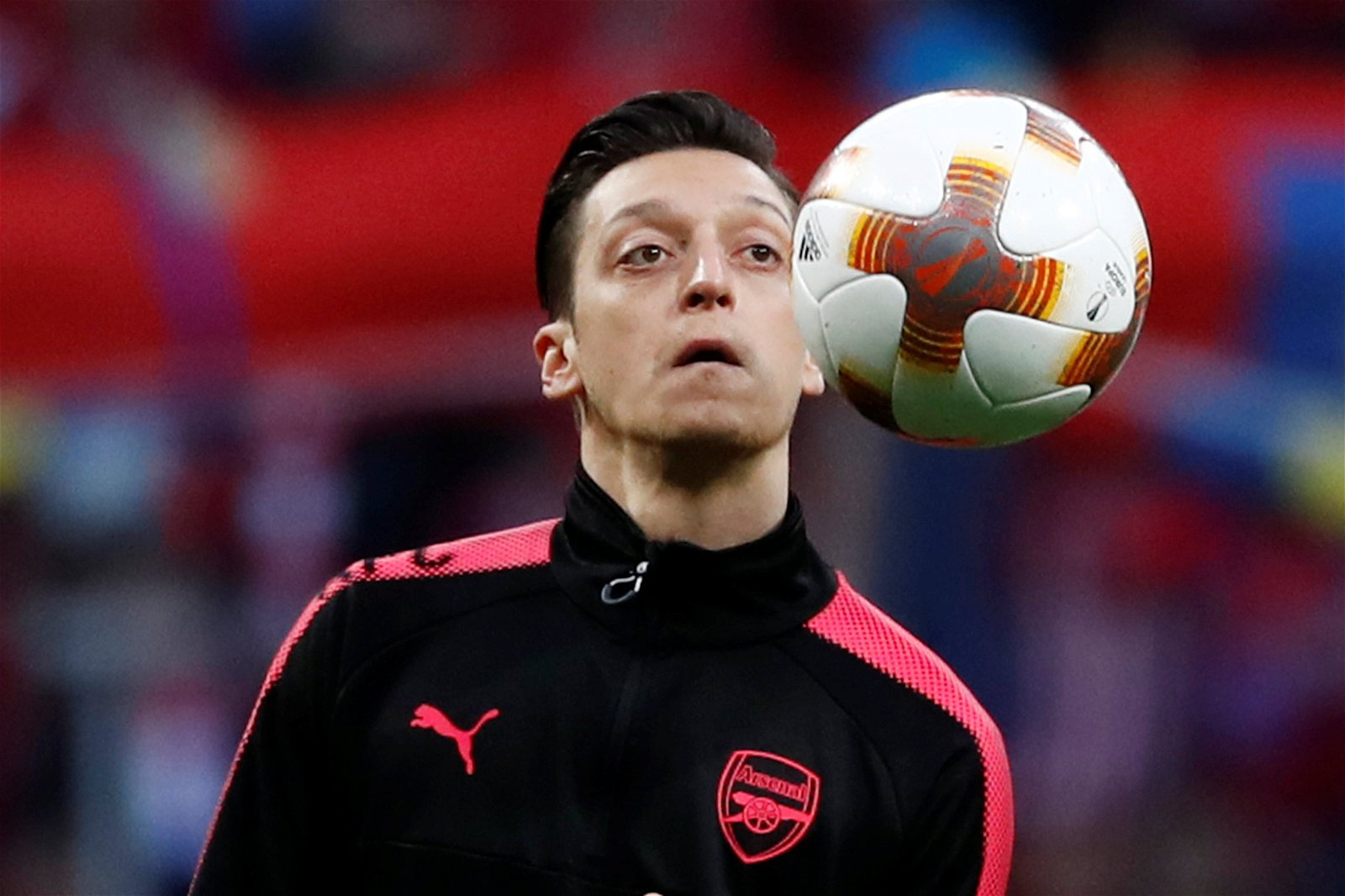 Mesut Ozil looks at the ball in training