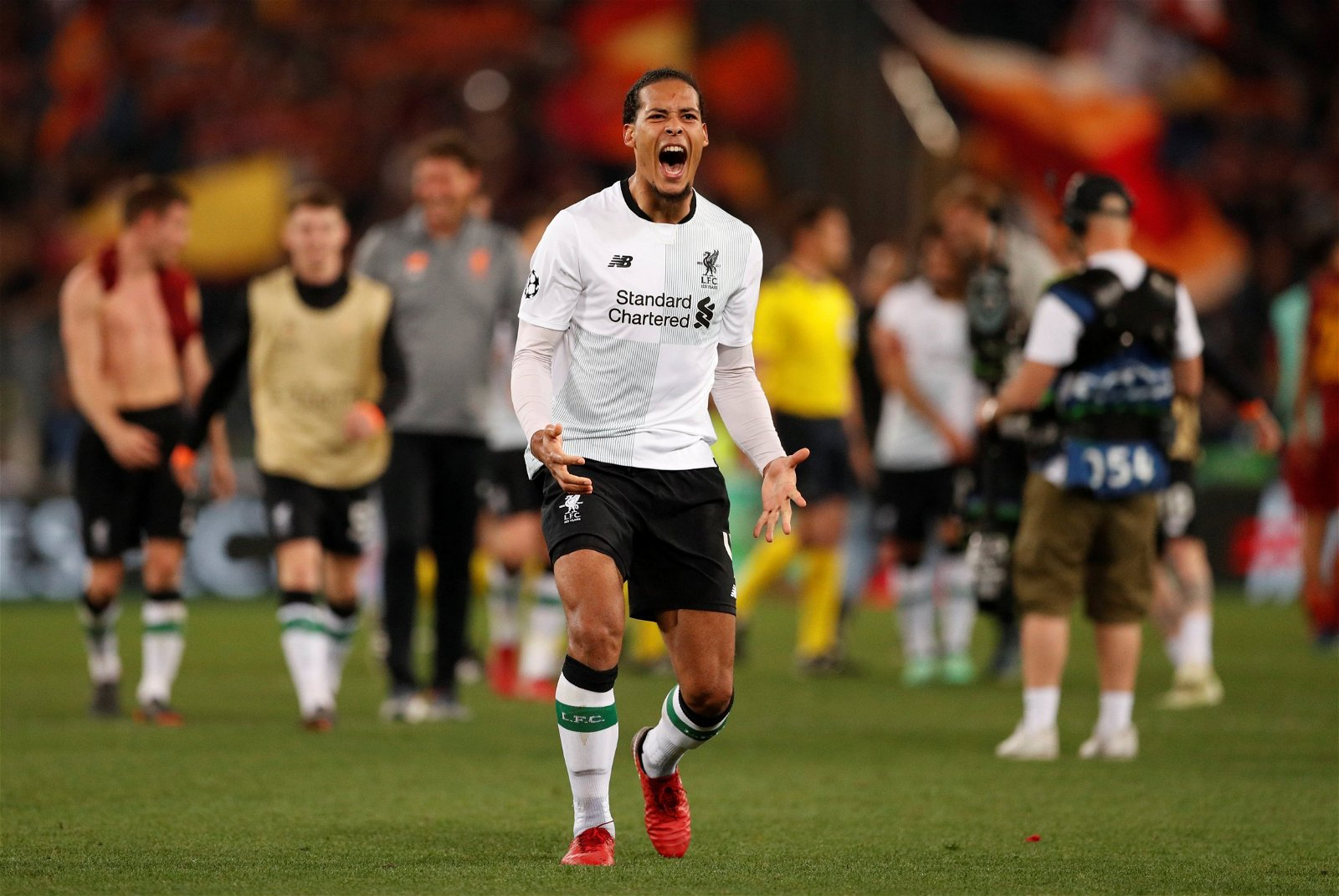 Virgil van Dijk celebrates making the Champions League final with Liverpool