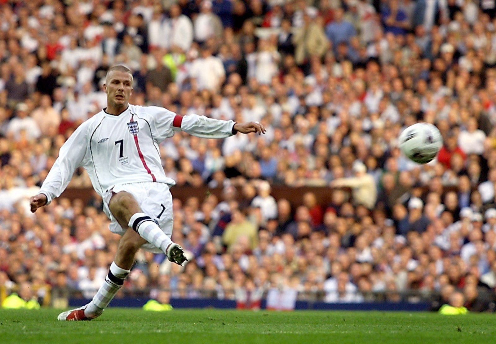 England's David Beckham scores against Greece in qualification for 2002 World Cup