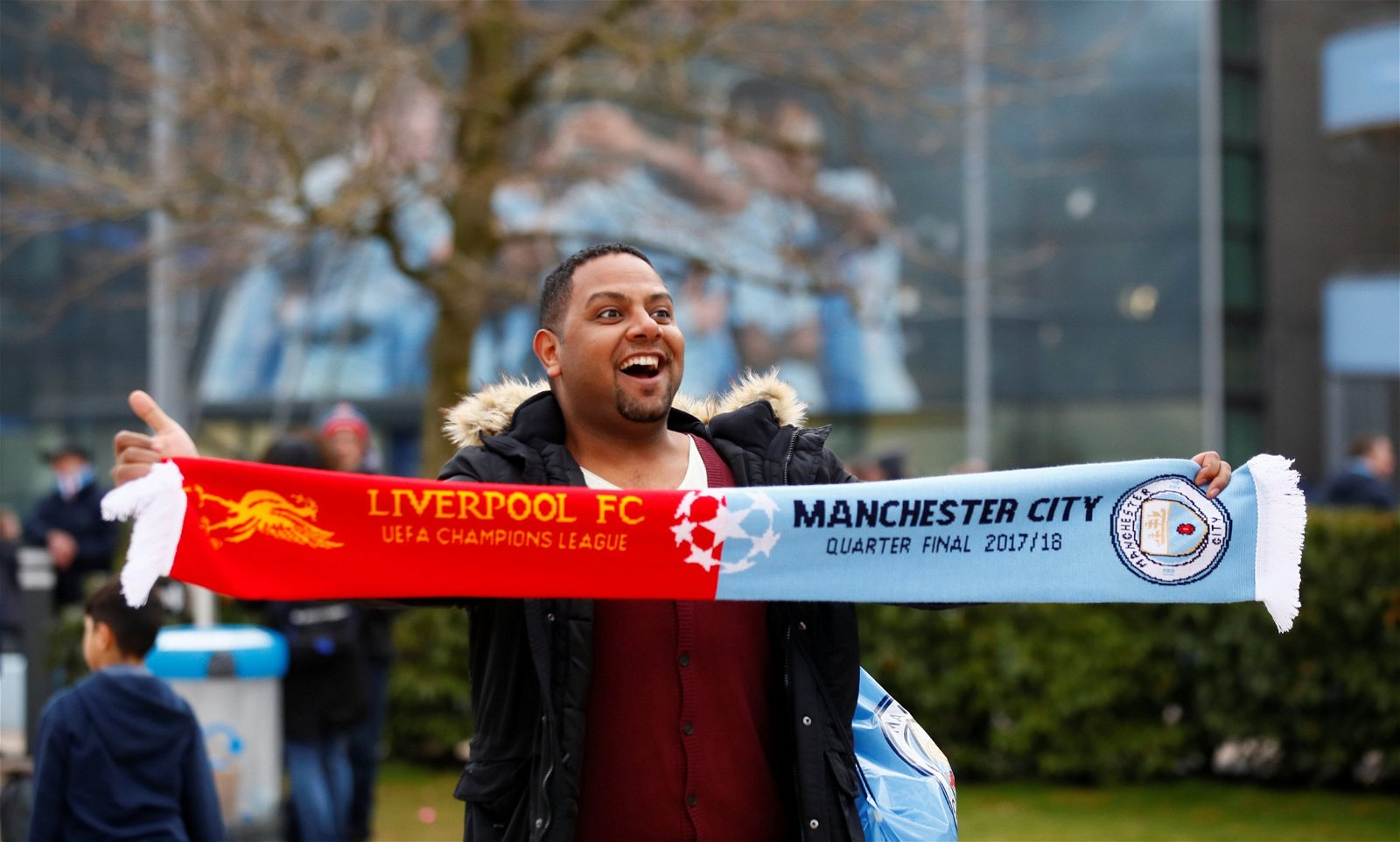 Fan with half and half scarf before Liverpool v Man City Champions League quarter final