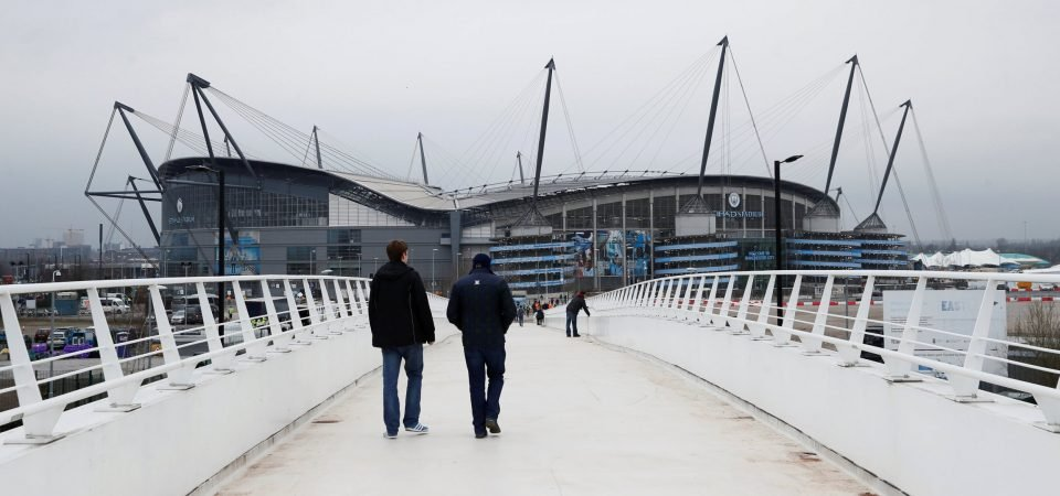 Manchester City fans react after UEFA begin to investigate the club