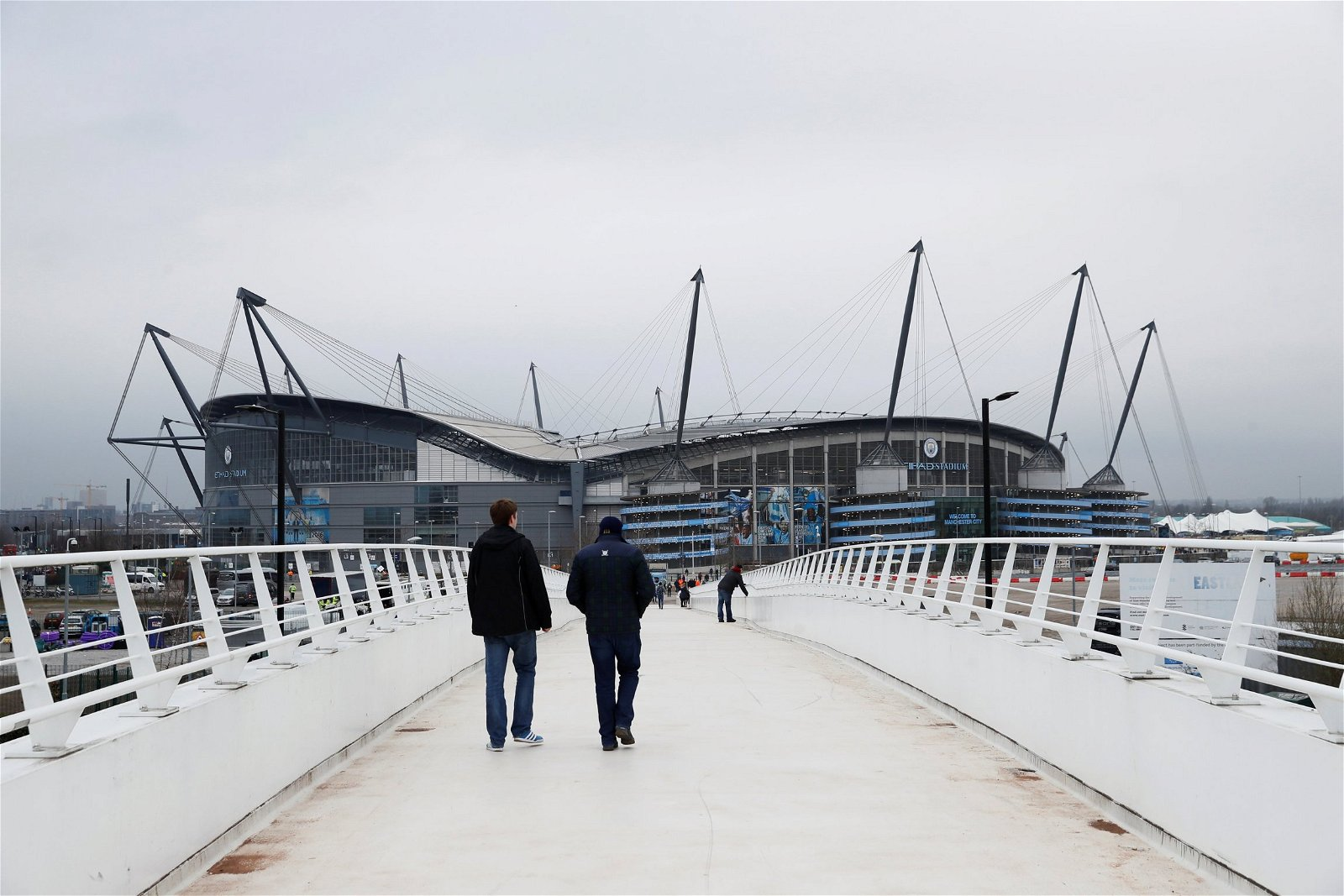 Fans arrive at the Etihad Stadium before a Man City game