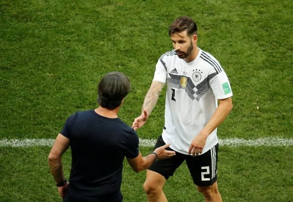 Germany's Marvin Plattenhardt shakes hands with coach Joachim Low after being substituted