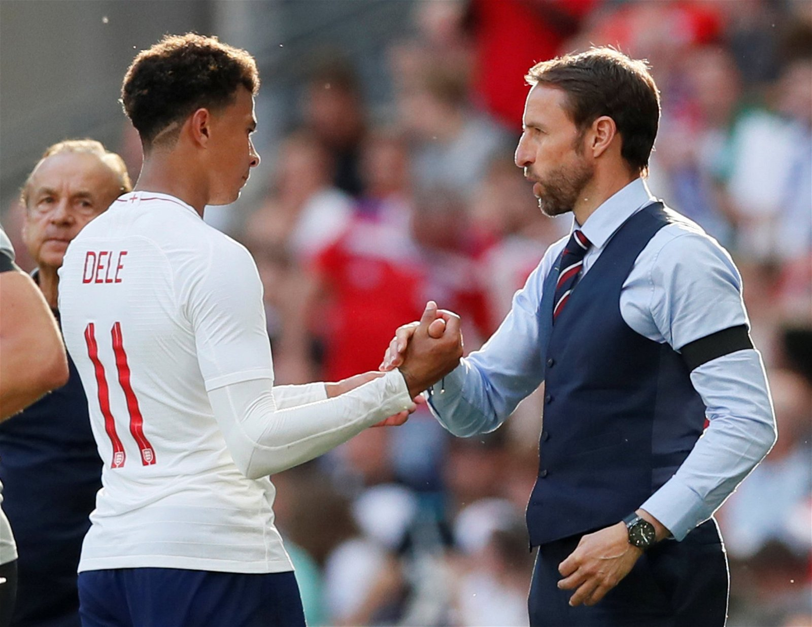 Dele Alli shakes hands with Gareth Southgate