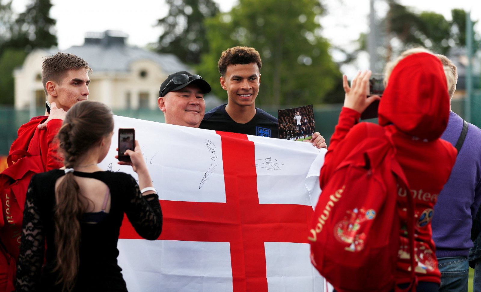 Dele Alli with an England fan in Russia