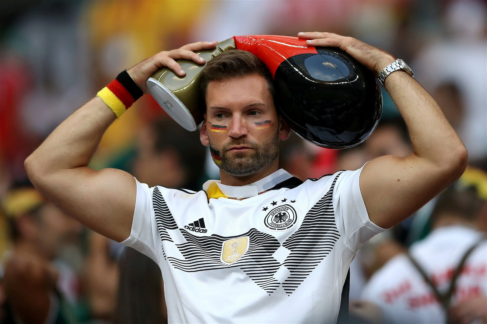 Germany fan looks distraught after losing against Mexico