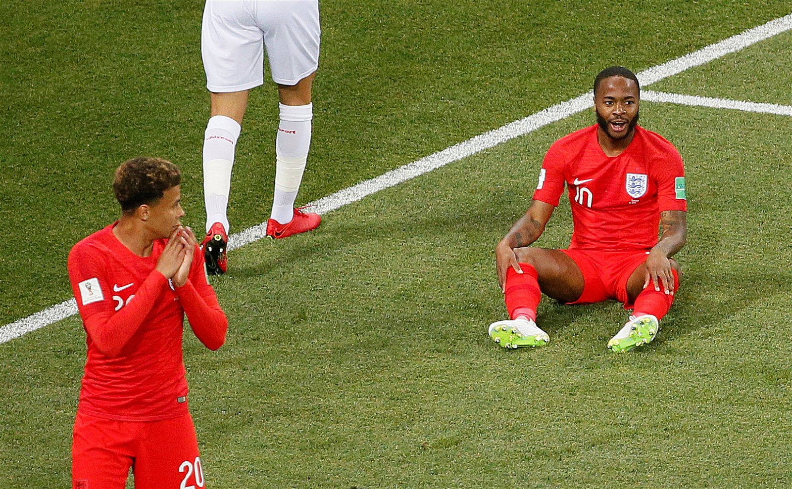 Raheem Sterling looks perplexed after missing an early chance for England