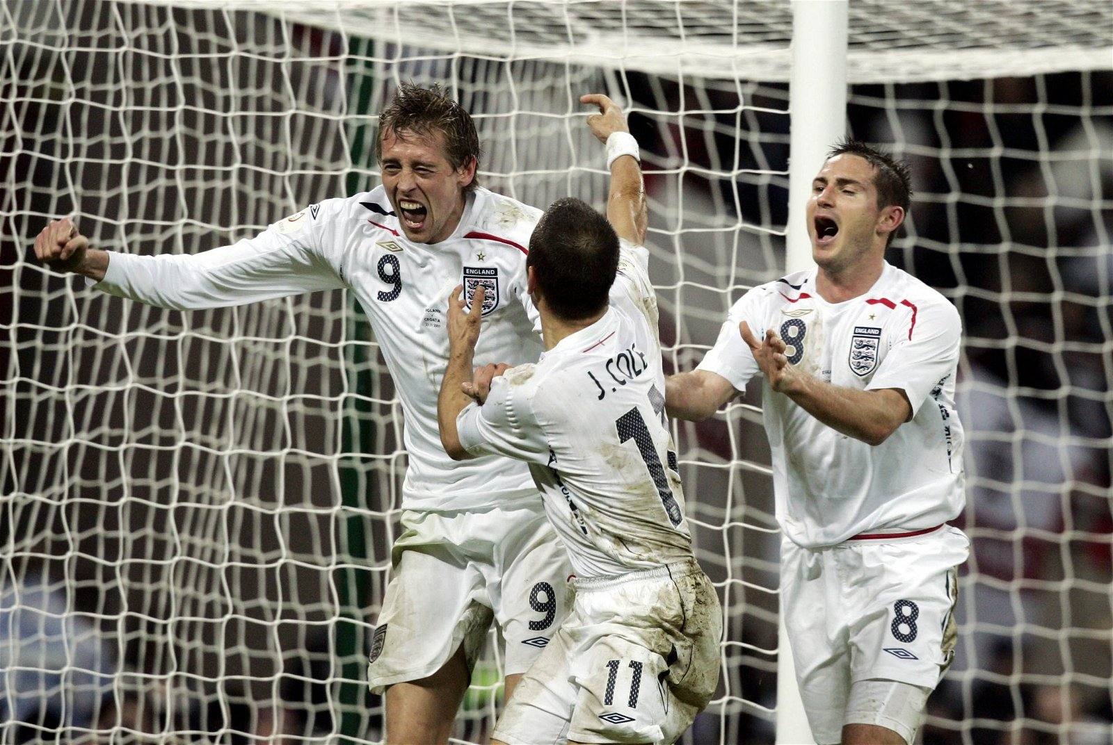 Peter Crouch celebrates scoring against Croatia with Joe Cole and Frank Lampard