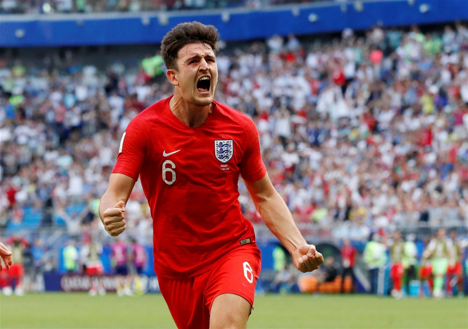 Harry Maguire celebrates scoring for England against Sweden at the World Cup
