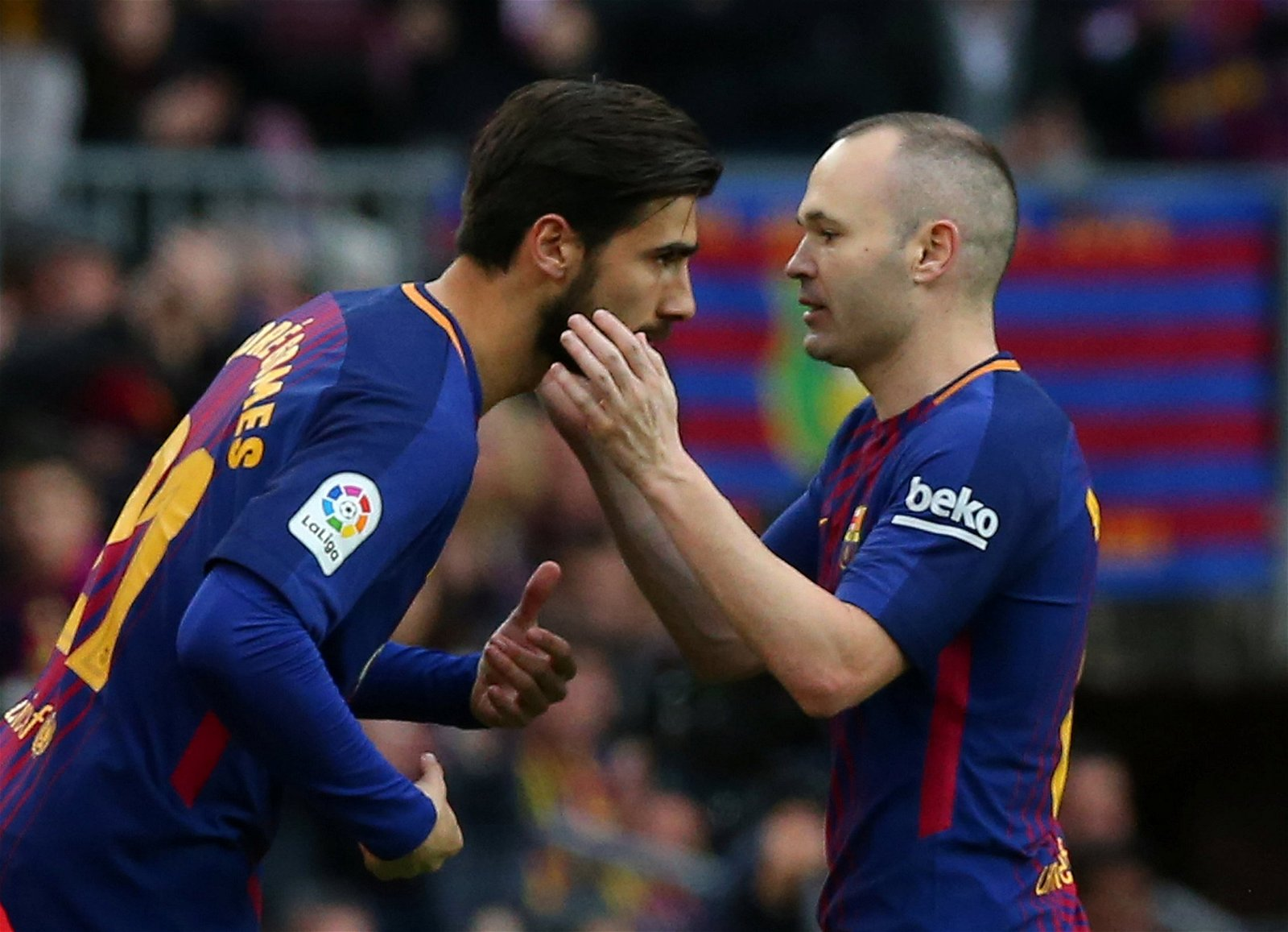 Andres Iniesta hugs Andre Gomes